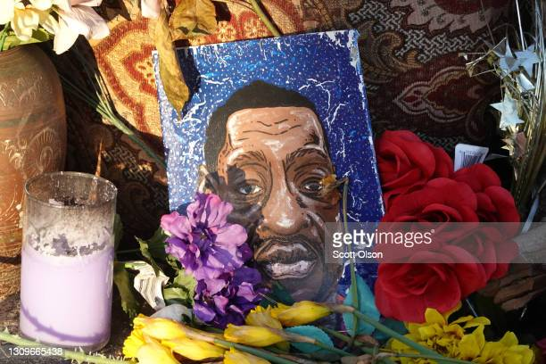 Portrait of George Floyd sits among flowers at a memorial near the site where George Floyd died at the hands of former Minneapolis police officer...