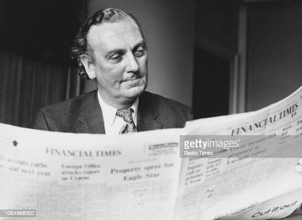 Portrait of George Scott reading the Financial Times May 20th 1976