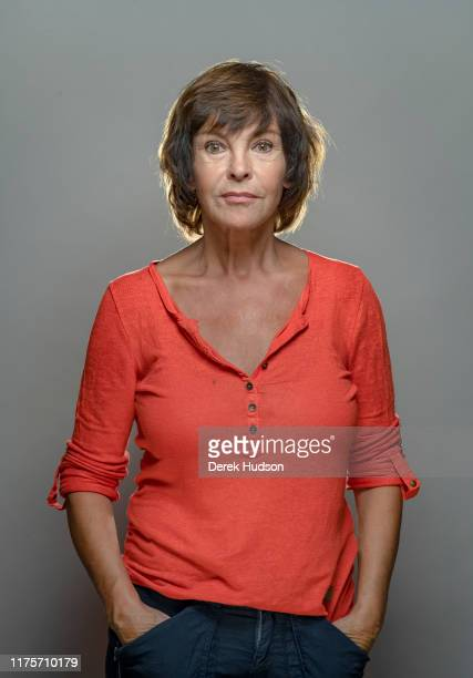 Portrait of German actress Katrin Sass as she poses hands in her pockets in front of a gray background Treptow Berlin Germany August 3 2019
