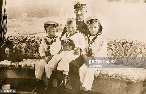 Portrait of German Emperor Wilhelm II as he poses with three of his grandchildren Prince Hubertus of Prussia Louis Ferdinand Prince of Prussia and...