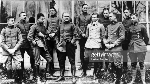 Portrait of German flying ace Baron Manfred von Richthofen center surrounded by other German officers 191Os Von Richthofen known as the Red Baron is...