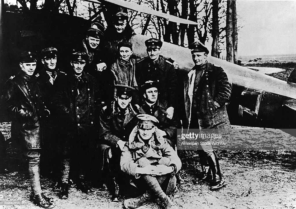 Portrait of German flying ace Baron Manfred von Richthofen (1892 - 1918) with his Pursuit Flight squadron on the Western Front, 1918. Von Richthofen, known as the Red Baron, is considered the most successful fighter pilot of all time, racking up 80 air combat battles in less than two years.