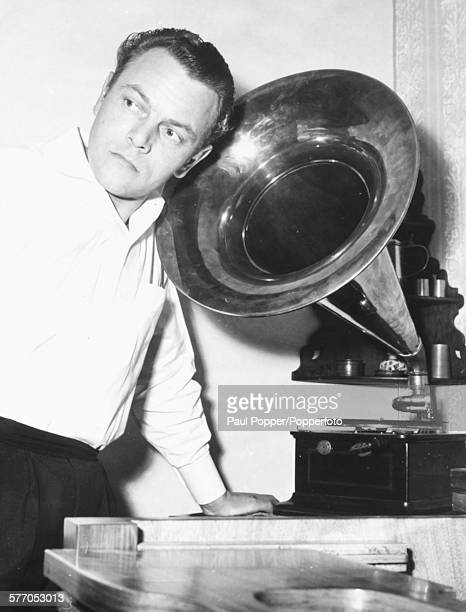 Portrait of German orchestra leader and musician Bert Kaempfert standing next to the horn of a vintage gramophone in Germany on 14th January 1961