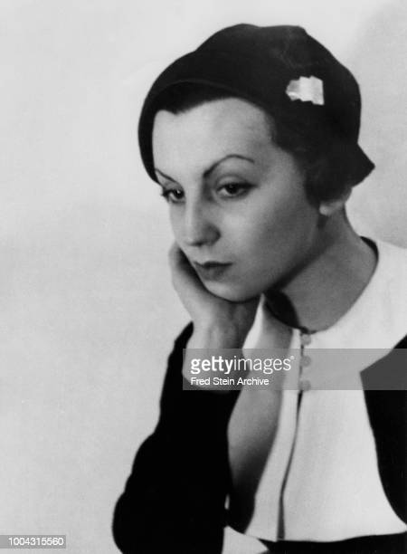 Portrait of German photographer Gerda Taro as she poses a hand on her chin Paris France 1936