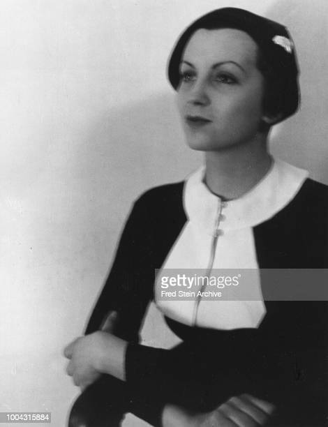 Portrait of German photographer Gerda Taro as she poses with her arms folded Paris France 1936