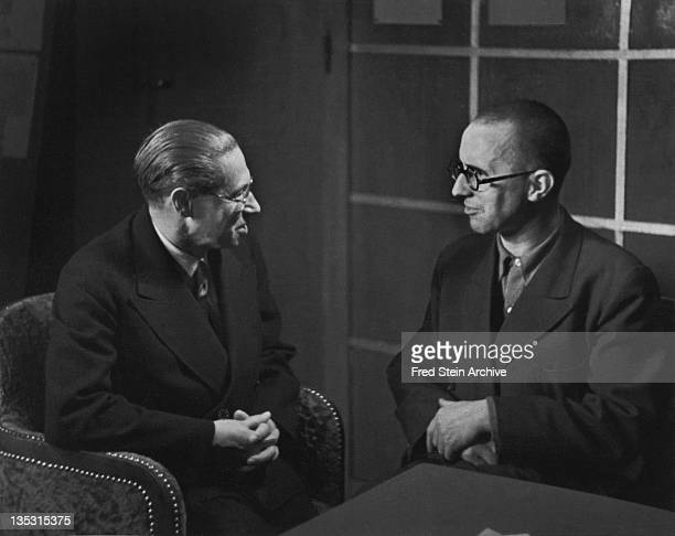 Portrait of German playwrights and authors Lion Feuchtwanger and Bertold Brecht as they sit together 1935