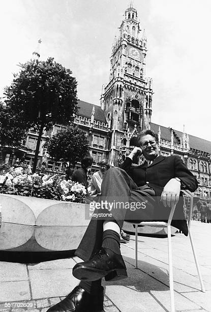 Portrait of German politician HansJochen Vogel sitting at a cafe in front of the Munich Town Hall June 27th 1972