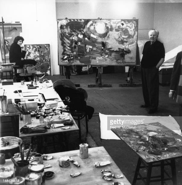 Portrait of Germanborn American painter and teacher Hans Hofmann as he poses with one of his works in his 8th Street studio New York New York...