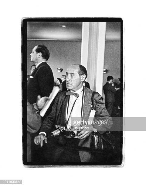 Portrait of German-born American photojournalist Alfred Eisenstaedt , several cameras around his neck, at the United Nations, New York, New York,...
