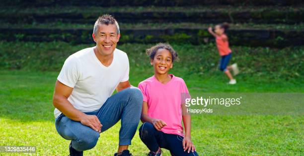 portrait of girl and coach posing during soccer training - football league stock pictures, royalty-free photos & images