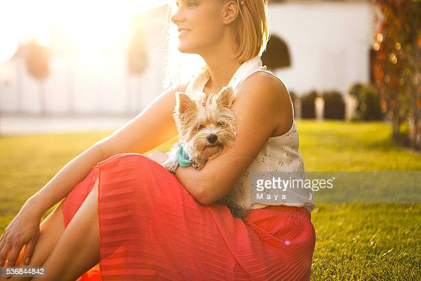 Portrait of girl and dog at meadow