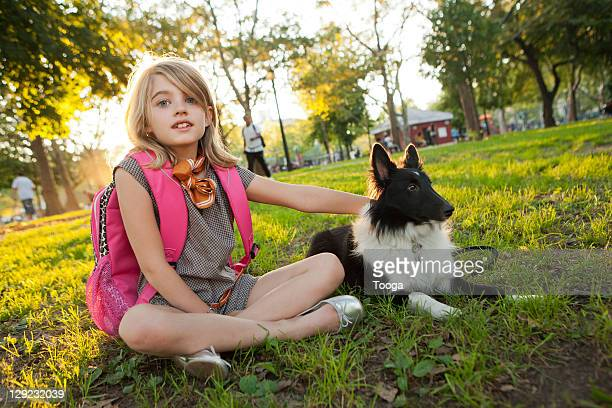 Portrait of girl and her dog in park