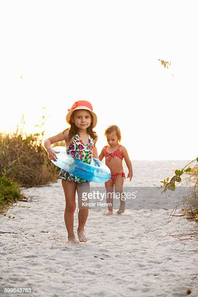 Portrait of girl and sister playing at beach, Sanibel, Florida, USA