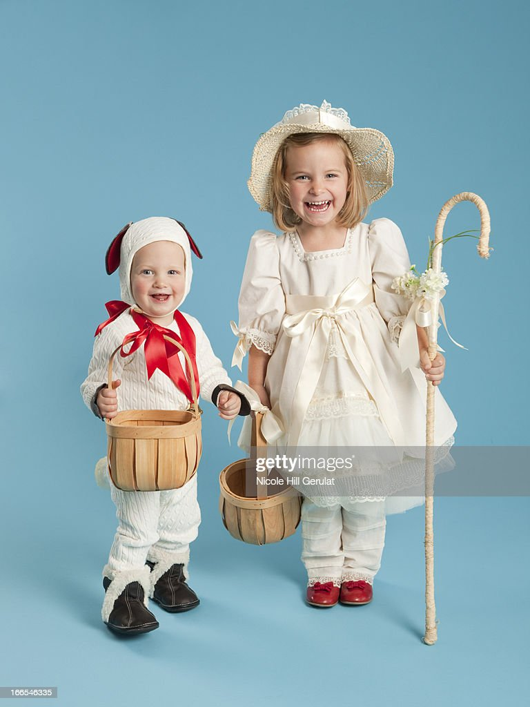 Portrait of girl (2-3) as Little Bo Peep with boy (12-17 months) as lamb for Halloween : Stock Photo