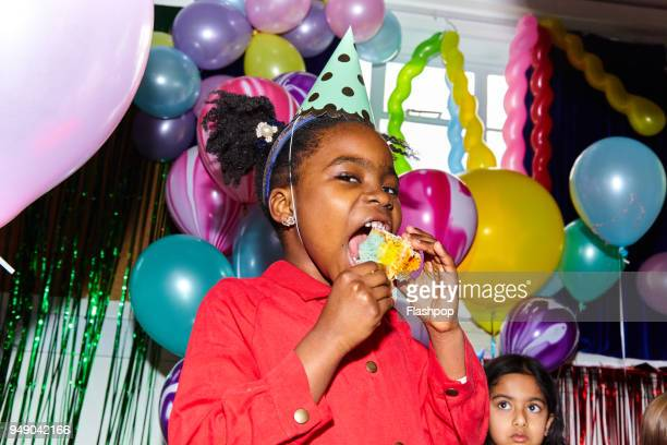 portrait of girl at a party - birthday cake stock pictures, royalty-free photos & images