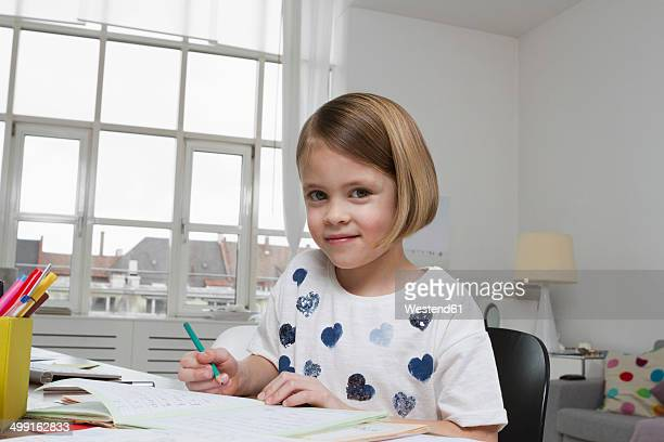 Portrait of girl at desk drawing