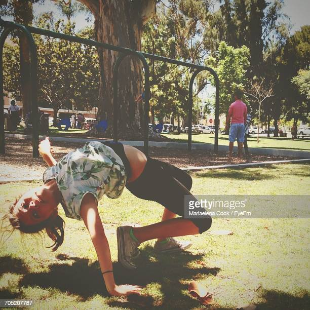 Portrait Of Girl Bending Over Backwards At Park