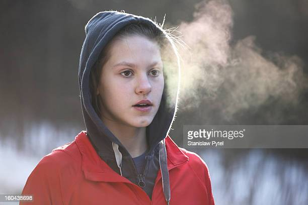 Portrait of girl breathing during morning jogging