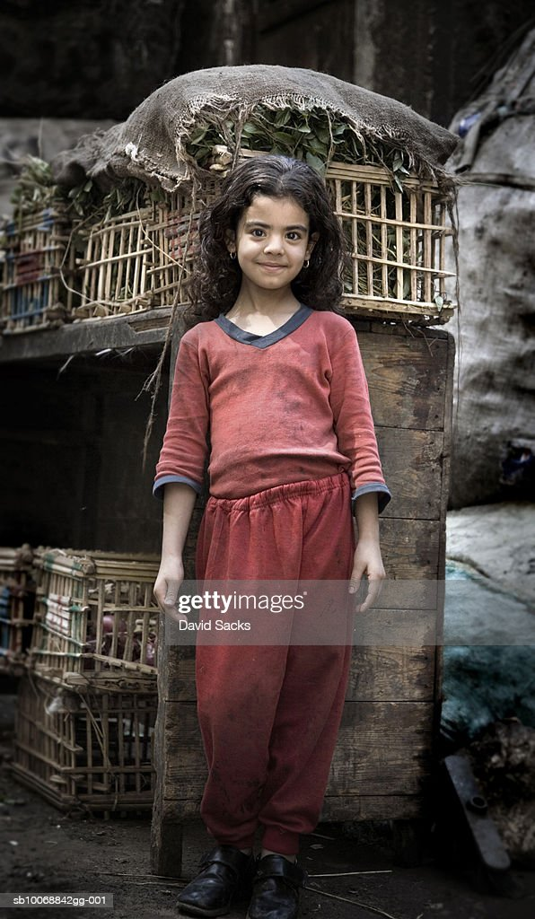 Portrait of girl (6-7) by bird cages : Stock Photo