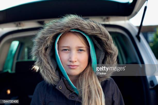 portrait of girl by car - st. albans stock pictures, royalty-free photos & images