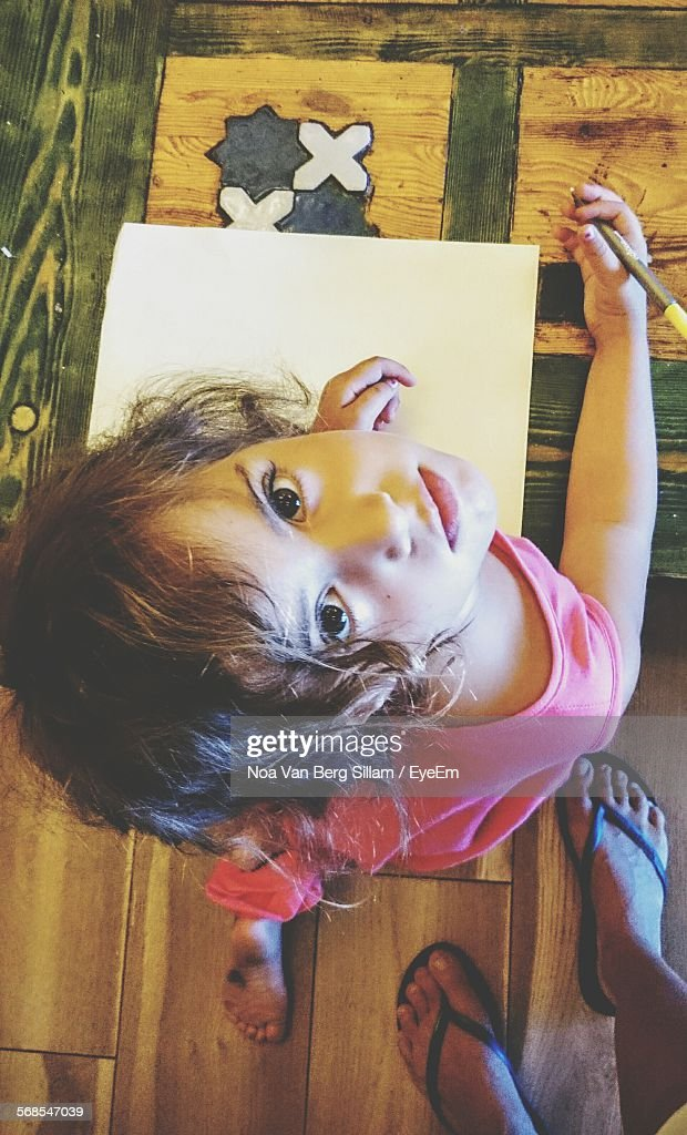 Portrait Of Girl Drawing On Paper At Home : Stock Photo
