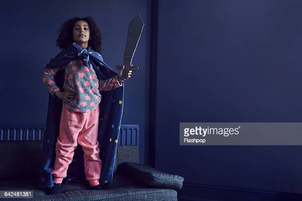 portrait of girl dressed as a superhero - superhero stock pictures, royalty-free photos & images