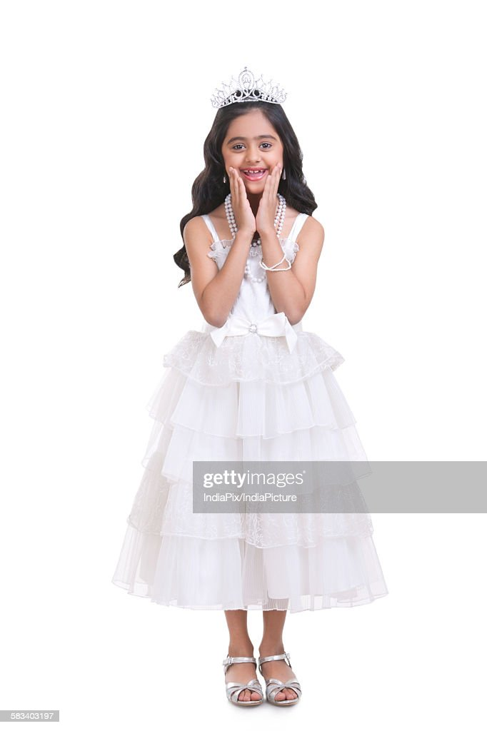 Portrait of girl dressed as prom queen : Stock Photo