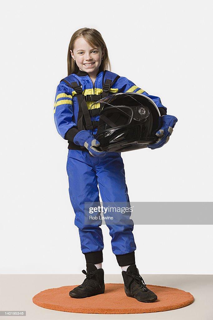 Portrait of girl (8-9) dressed as racing driver, studio shot : Stock Photo