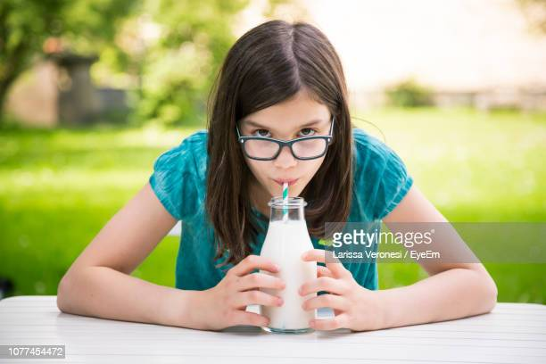 Portrait Of Girl Drinking Milk From Straw