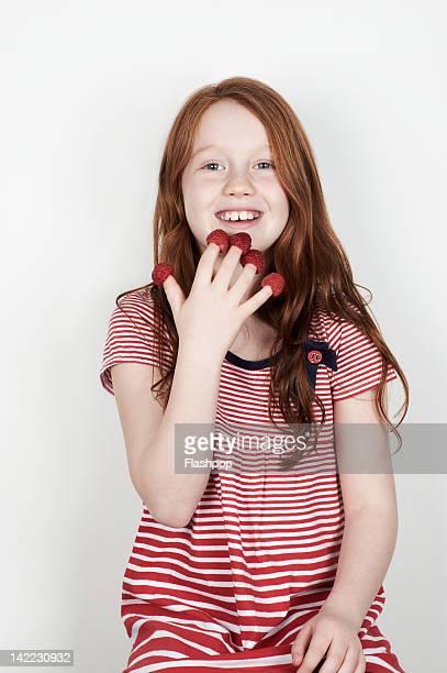 Portrait of girl eating fruit