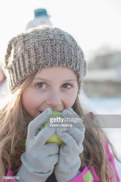 Portrait of girl eating green apple