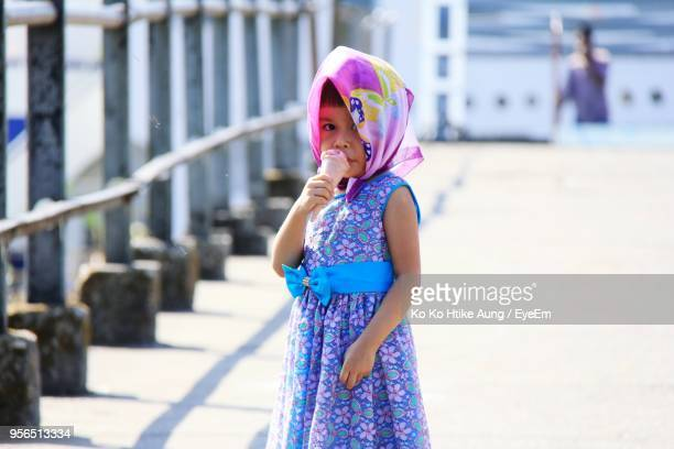portrait of girl eating ice cream - ko ko htike aung stock pictures, royalty-free photos & images