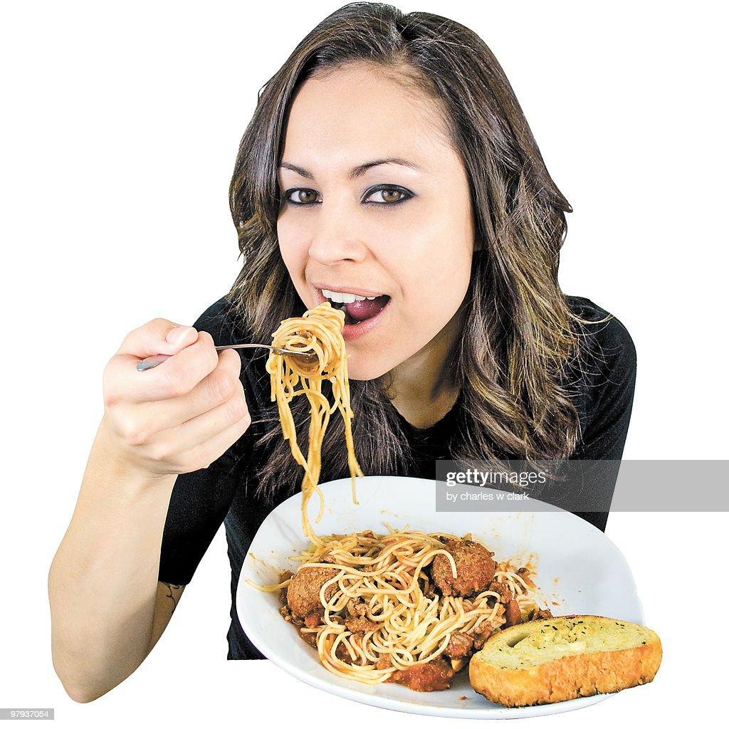 Portrait of girl eating  of spaghetti : Stock Photo