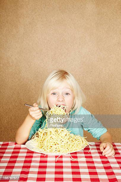 Portrait of girl eating spaghetti