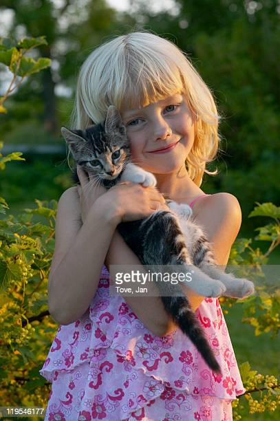 portrait of girl embracing cat outdoors - young girl breasts stock pictures, royalty-free photos & images