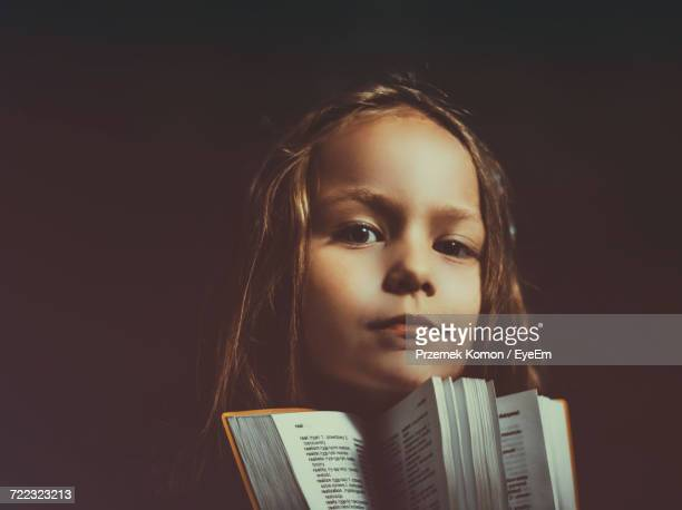 Portrait Of Girl Holding Book