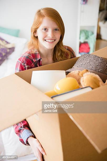 Portrait of girl (12-13) holding box, Jersey City, New Jersey, USA