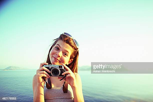 portrait of girl holding camera on holiday, kas, turkey - funny turkey images stock photos and pictures