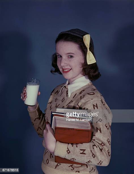 portrait of girl holding glass of milk and book  - {{relatedsearchurl(carousel.phrase)}} stock pictures, royalty-free photos & images