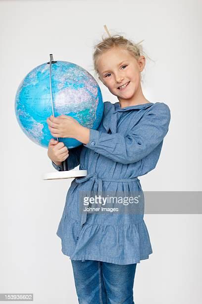 Portrait of girl holding globe