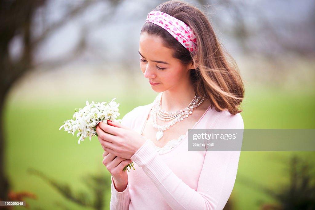 Portrait of Girl Holding Handpicked Snowdrops : Stock Photo