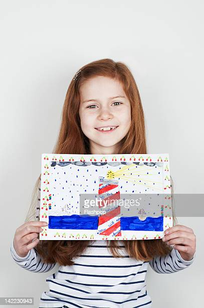 Portrait of girl holding her painting