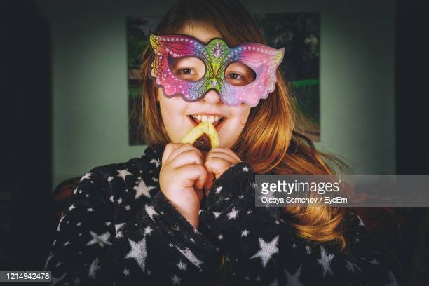 portrait of girl holding mask - judaism stock pictures, royalty-free photos & images