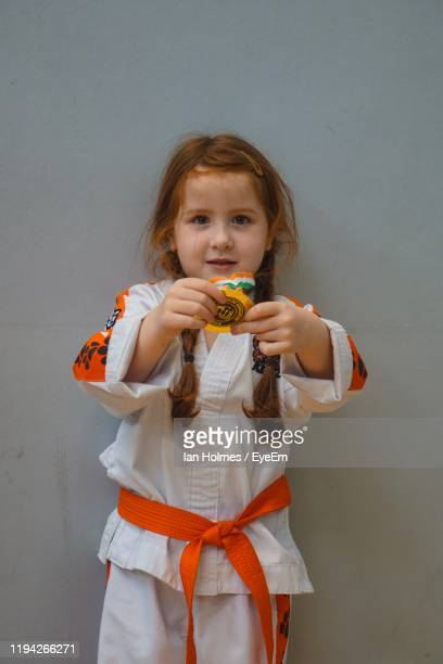 portrait of girl holding medal - medallist stock pictures, royalty-free photos & images