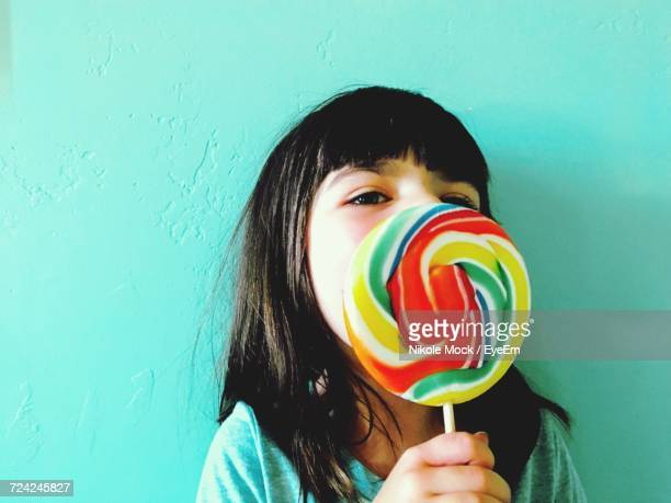 Portrait Of Girl Holding Multi Colored Lolipop