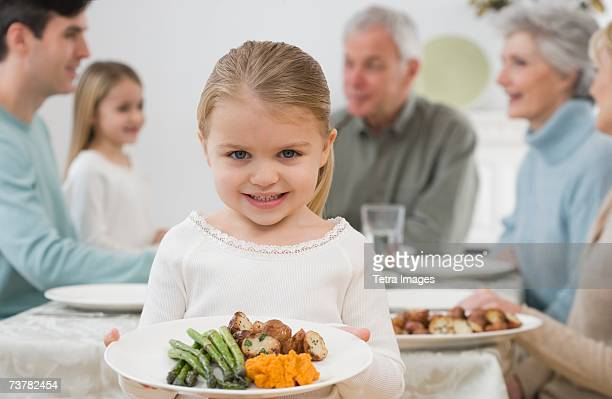 Portrait of girl holding plate at Thanksgiving