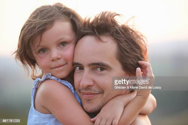 Portrait of girl hugging father, Buonconvento, Tuscany, Italy