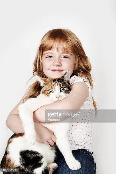 portrait of girl hugging her pet cat - one animal stock pictures, royalty-free photos & images