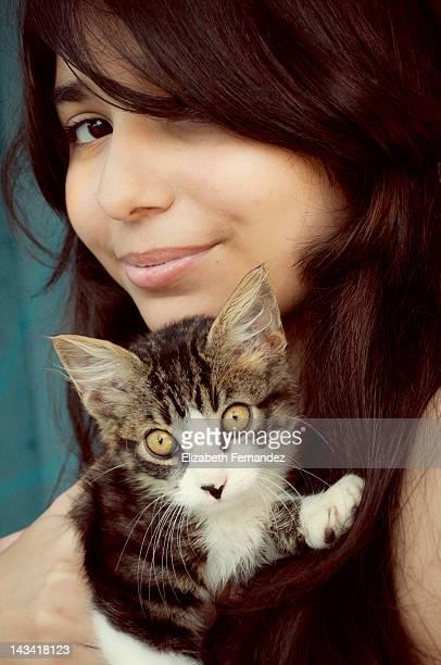 Portrait of girl hugging kitten
