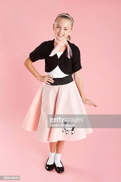 portrait of girl (10-11) in 1950s style costume for halloween - poodle skirt stock photos and pictures